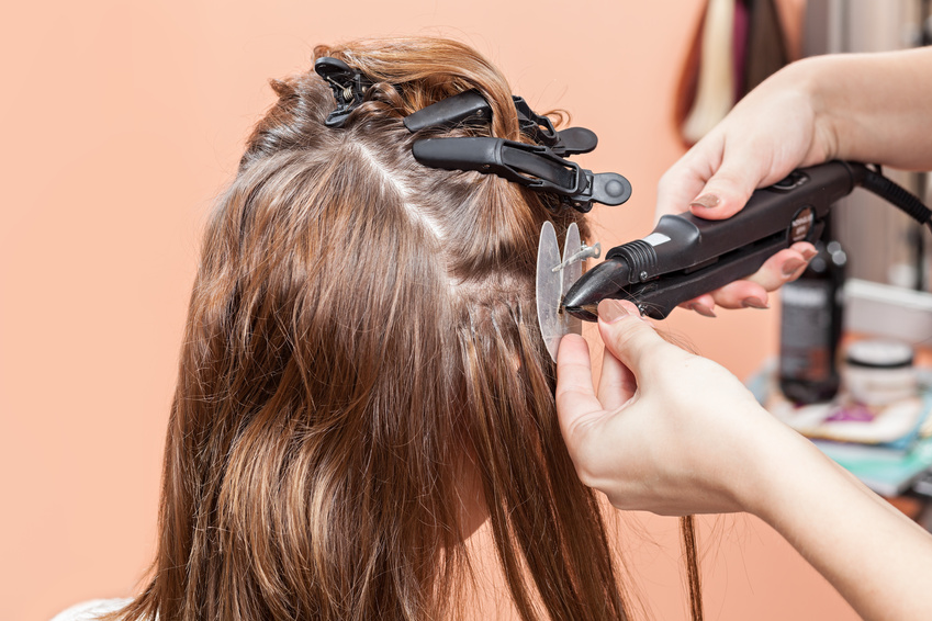 Hair salon, beauty spa. Procedure of hair extensions